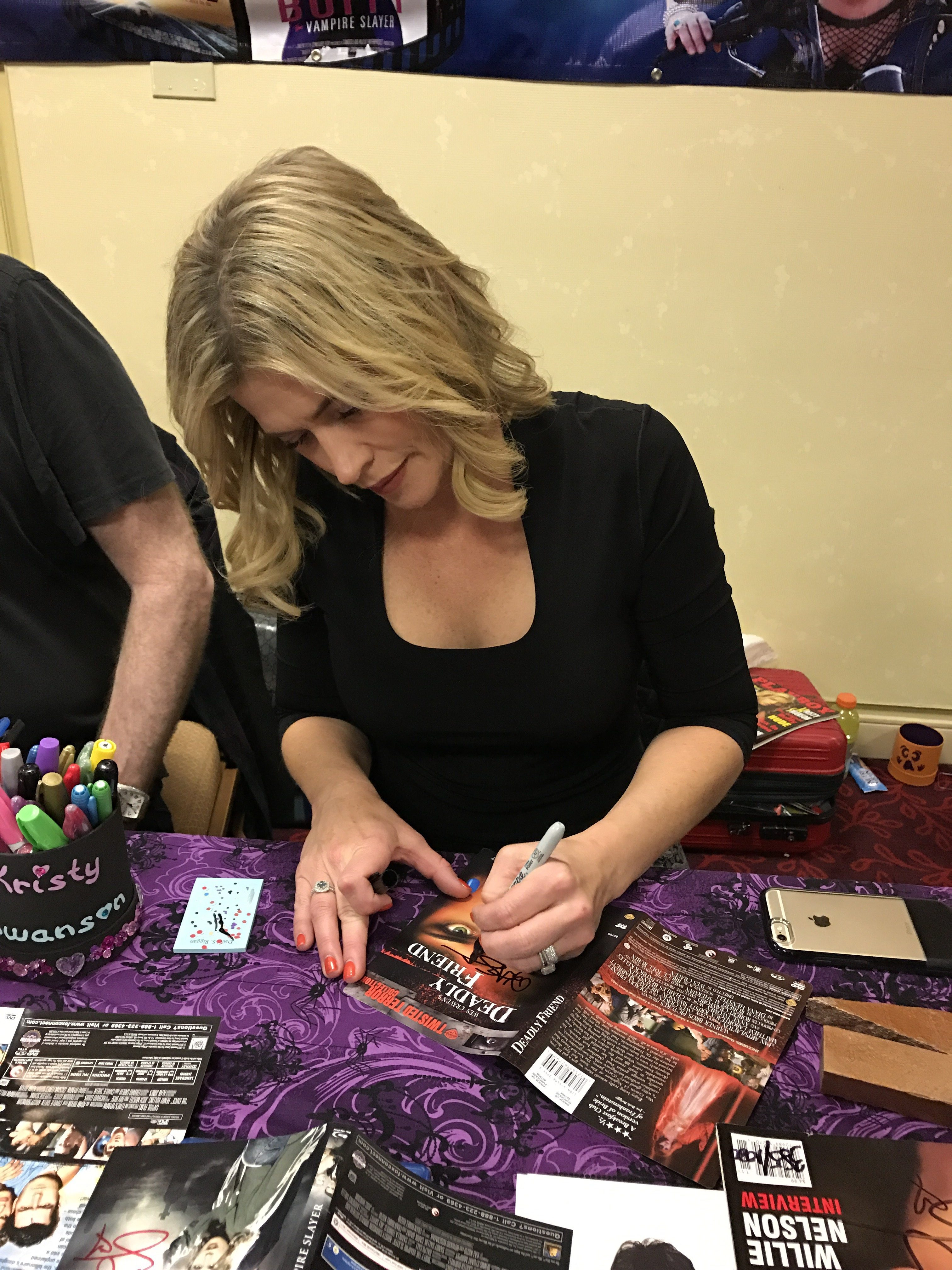 """Kristy Swanson signs """"Deadly Friend"""" DVD for Now Playing Podcast host Arnie Carvalho."""