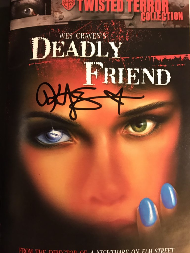 "Kristy Swanson signs cover of ""Deadly Friend"" DVD"